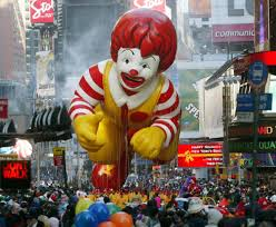 the ronald mcdonald balloon makes his way through times square