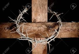 crown of thorns hung around the easter cross stock photo picture