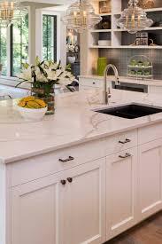 white shaker kitchen cabinets with gray quartz countertops low maintenance kitchen countertops options countertopsnews