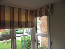 roman blinds in a bay window striped roman blinds using ro u2026 flickr