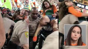 miami fan slaps officer video shows violent altercation between woman officer during um