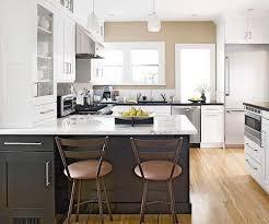 peninsula island kitchen two tone white kitchen cabinets black quartz countertops black