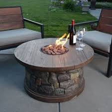 Propane Fire Pits With Glass Rocks by How To Build A Propane Fire Pit Dining Table Backyard