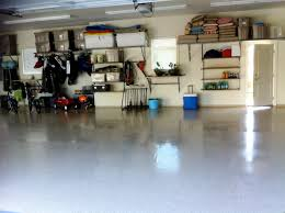 basement storage shelves floor painted with white epoxy color remodel basement garage house