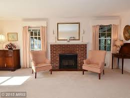 traditional living room with carpet u0026 metal fireplace in arlington