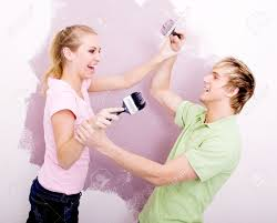 Paint House Couple Having Fun While Painting House Stock Photo Picture And