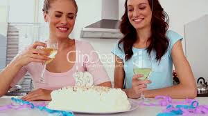 wine birthday candle woman blowing out candle on her birthday cake royalty free video