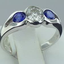 bezel set engagement ring 14k half bezel diamond and sapphire engagement ring exeter jewelers