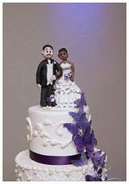african american bride and caucasian groom figurine wedding cake