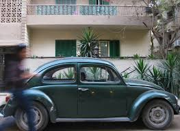 green volkswagen beetle volkswagen beetle see cairo through my eyes