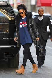 Celebrity Clothing For Men Rihanna Keeps Things Classic In Camel Timberlands And Fila