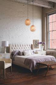 romantic bedroom for couples with double pendant lighting over the