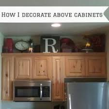Decorations For Above Kitchen Cabinets Above Cabinet Decorating Like The Eat Decorating Ideas