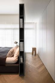 small bedroom with headboard storage and room divider