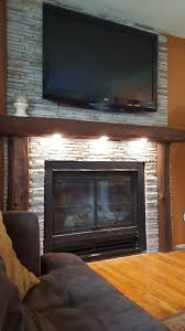recessed lighting over fireplace our fireplace with recessed lighting the hand hewn beams came from