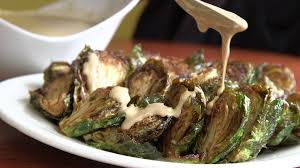 thanksgiving brussel sprout recipes brussels sprouts with pomegranate tahini sauce recipe nyt cooking