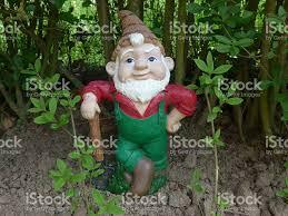 ateiname garden gnome with shovel at work stock photo 626590594