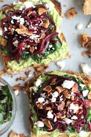 avocado toast with spiralized beets garlic swiss chard bacon