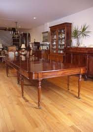 long and wide two part english banquet dining table in mahogany