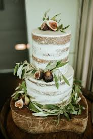 picture of fall wedding cake with pears blackberries and purple