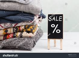 sweaters for sale shopping warm sweaters sale signboard stock photo 551433058