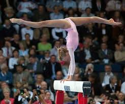 gymnasts on beam