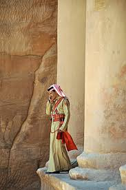 Michael Frost, a 40-year-old graduate student in journalism, photographed a traditionally-dressed guard as he spoke on his mobile phone outside of al-Khazneh (Treasury) in Petra, Jordan.