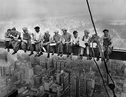 construction workers lunching on a crossbeam 1932