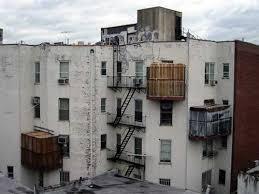 Three sukkot on balconies