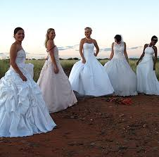 girls in wedding dresses