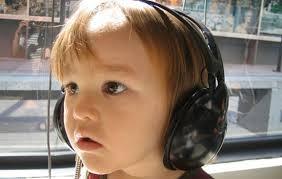 child listening to music