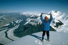 Female Mountaineer On Summit