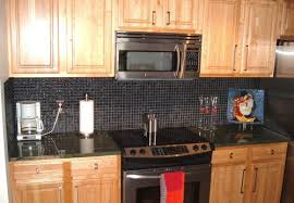 black glass tile backsplash