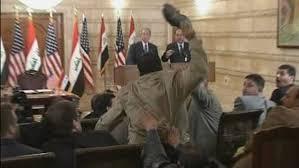 president bush dodges shoe