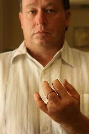man with long fingernails