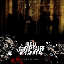 red jumpsuit apparatus face down