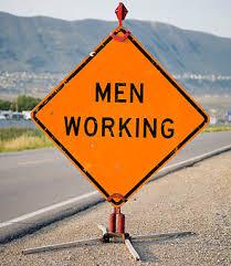 men working signs