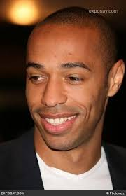 Thierry Henry...jesus christ - thierry-henry-tommy-hilfiger-and-thierry-henry-new-hilfiger-flagship-store-in-london-photocall-and-press-conference-0aHvWt
