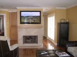 flat panel tv over fireplace