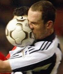 soccerball in face