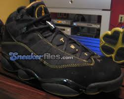 black and gold jordan