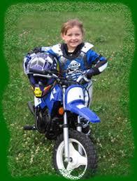 kids riding dirt bikes