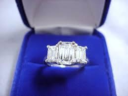 3 stone emerald cut ring