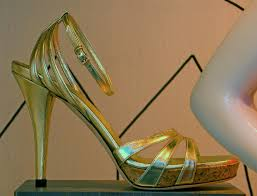 gold high heeled shoes