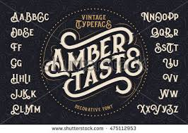 Vintage Decorative Font Named Amber Taste With Label Design And Background Pattern