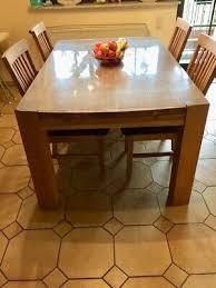 esstisch goliath mit zusatztischplatte vier stühle massiv