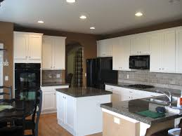 Bronze Single Hole Faucet Kitchens With Black Appliances And White Cabinets Fake Wood Flooring Idea Undercabinet Range Hood Recessed Cabinet Light