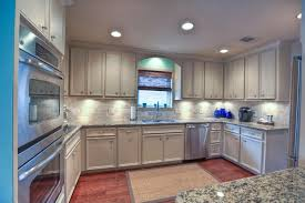 traditional kitchen with crown molding flat panel cabinets in