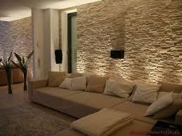 wohnzimmer mit steinwand mit beleuchtung steinwand