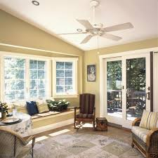 Cozy Sunroom Interior With Brown Wooden Upholstered Rocking Chair And White Ceiling Fan Plus Lighting Combined Furniture